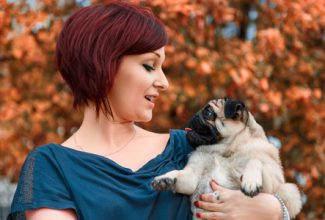 Woman speaking canine to pug